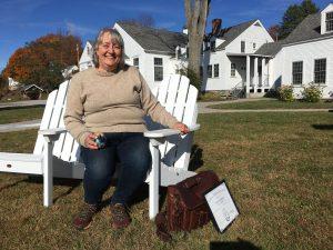 Allison Turner sitting on chair in a backyard