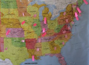 of map the United States with sticky notes marking certain states