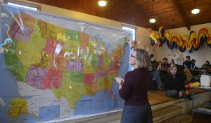 person looking at United States map during a town meeting
