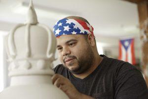Roberto Lugo carving into a ceramic