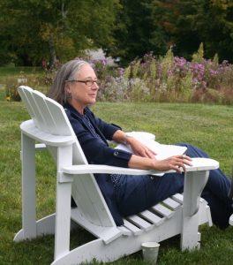 President Ellen McCulloch-Lovell sitting in a white lawn chair