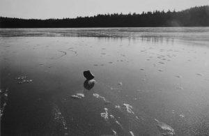 A stone on a frozen lake.
