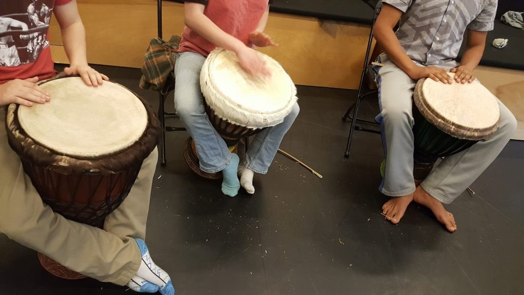 students playing the drums