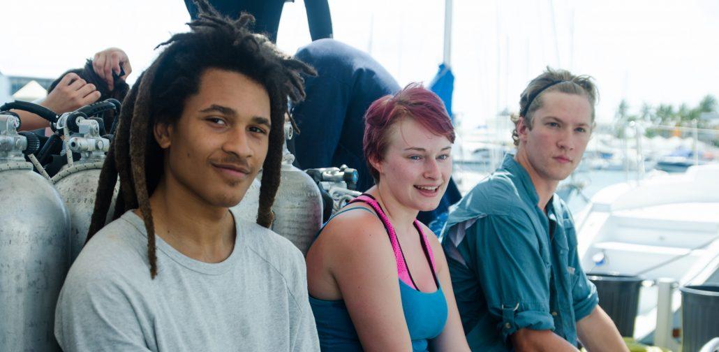 Menefese Kudumu-Clavell sitting next to two friends