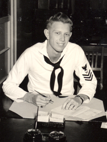 Jim Shingle seated at a desk wearing a navy uniform