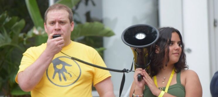 Jordon Dyrdahl-Roberts (left) speaking into a microphone