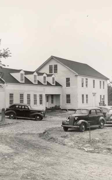 Image of the main Marlboro College building from the late 1940s with two cars in front