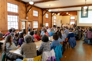 Students, faculty members, and staff members gathered at a town meeting