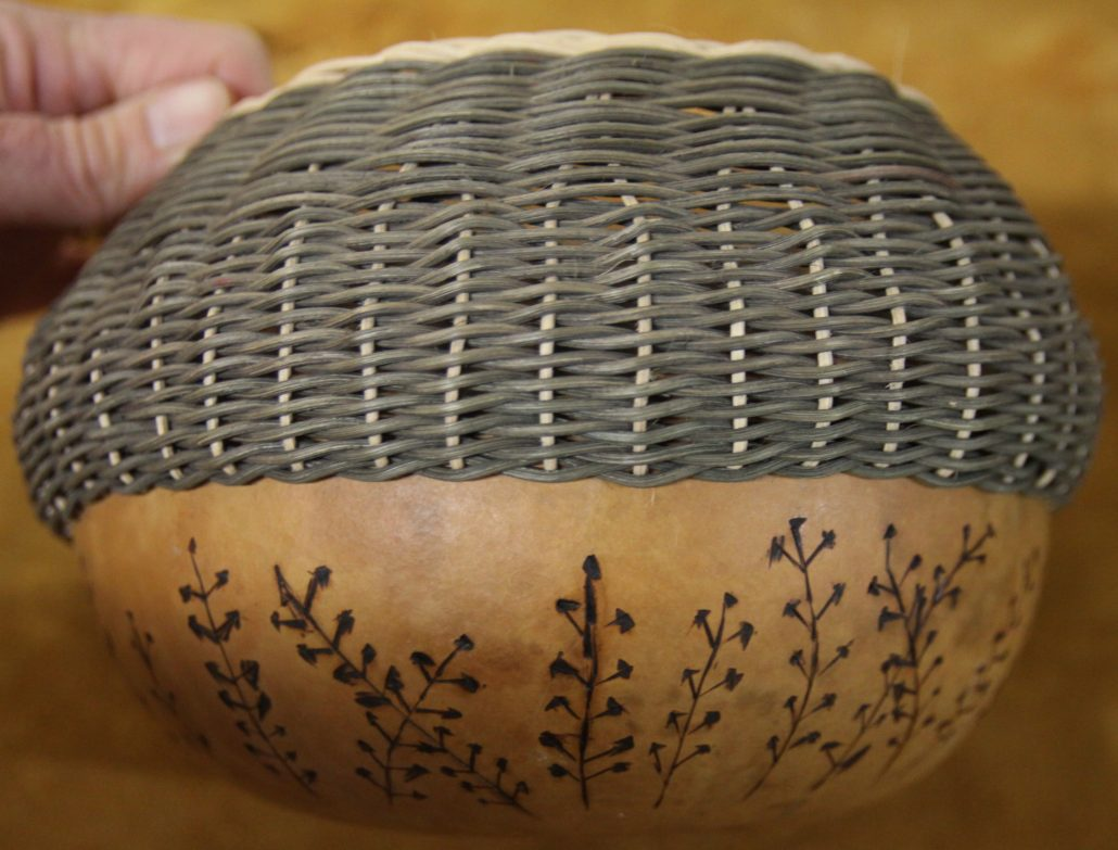 A homemade basket featuring elements of weaving and flora motifs