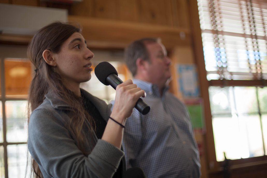 Emmanuel Miller speaking at a town meeting