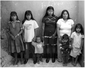 Family standing in front of a wall