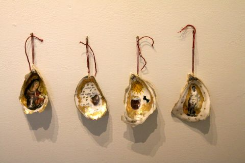 four shells with paintings inside